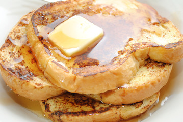 Close-Up of French Toast with Butter and Syrup