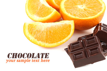 Chocolate and orange isolated on white