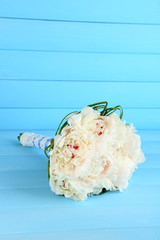 Beautiful wedding bouquet on  color background