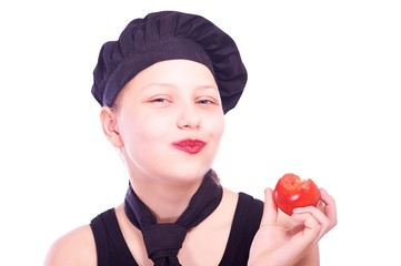 Teen girl eating tomato