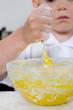 Little boy mixing cake ingredients