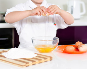 Young boy earning to be a chef