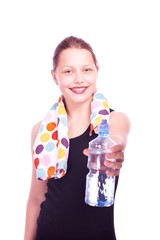 Teen girl holding towel and bottle of water