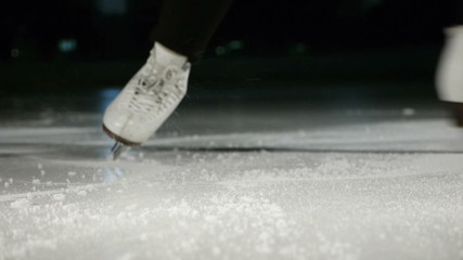 figure skating white skates stopping
