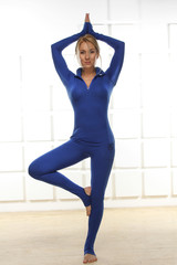 Sexy in blue skintight suit exercisers yoga fitness gym aerobics