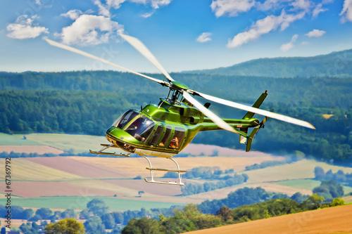 Foto op Canvas Helicopter Hubschrauber in der Kurve