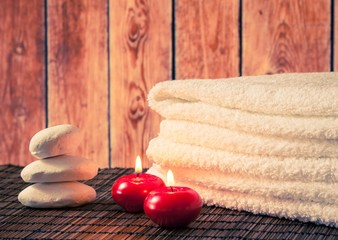 Spa massage border with towel stacked candles warm atmosphere