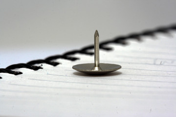 Thumbtack on a book