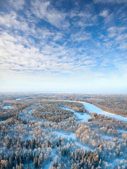 Top view of trees in hoar beside river in winter