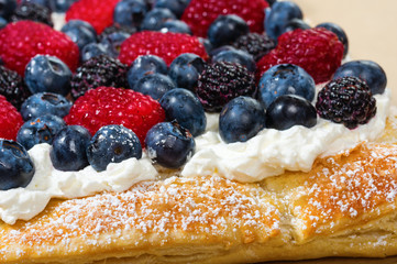 Fresh berry tart with cream and sugar