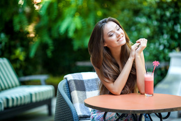 Happy Beautiful Woman with Fresh Juice
