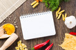 spices and vegetables around notebook