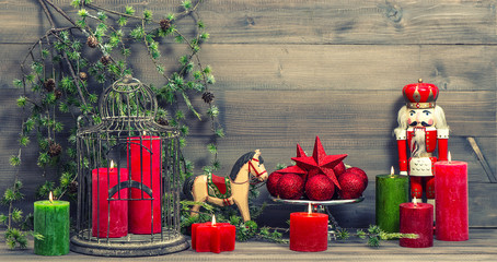 christmas decorations with red candles and vintage toys
