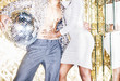 canvas print picture - 70s disco style couple posing with mirror ball