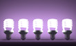 Row of glowing spiral light bulbs on violet
