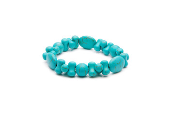 Bracelet from  turquoise stone isolated on a white background