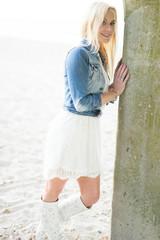 Beautiful trendy blond woman on the beach