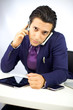 Busy businessman with two phone working at desk