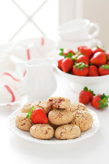 Oat bran, coconut and strawberry cookies, selective focus