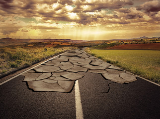 Asphalt road with cracks. Concept of problem and solution.