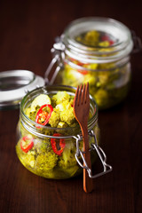 Broccoli and turmeric pickles, selective focus