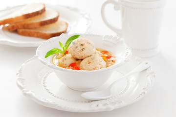 Soup with chicken meatballs and vegetables, selective focus
