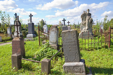 Old graves at cemetery in Grondo, Belarus.
