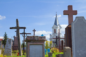 Old graves and church at cemetery in Grondo, Belarus.