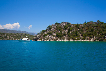 Bay in mediterranean sea with yacht in the Kekova