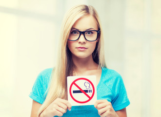woman with smoking restriction sign