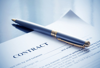 Pen on the contract papers