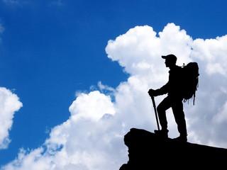 Man standing on summit of mountain.
