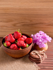 Still life of strawberries, cookies and cloves