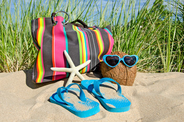 coconut with sunglasses and flip-flops