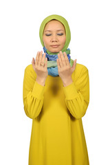 Beautiful young moslem woman praying