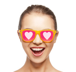 happy teenage girl in shades with hearts