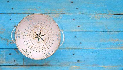 Old Colander, on old blue wooden table, free copy space