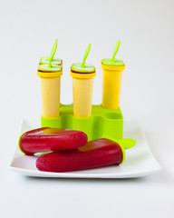 popsicles in yellow cups in ice cream maker