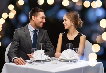 smiling couple looking at each other at restaurant