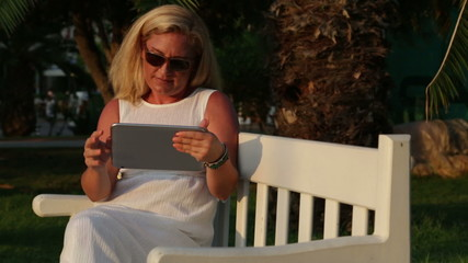 Woman Surfing Internet On Digital Tablet
