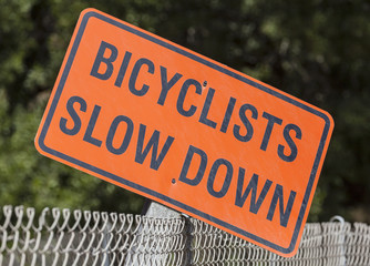 Bicyclists Slow Down Sign