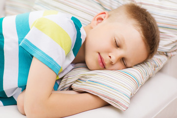 little boy sleeping at home
