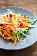 fresh arugula salad with carrots
