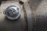 Filler cap in the tank of a truck poster