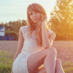 Sunny outdoors portrait of a beautiful young romantic woman or