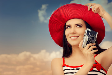 Beautiful Girl with Camera on Blue Sky
