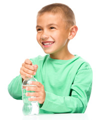 Boy with plastic bottle of water