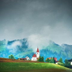 Church on the hill in the Alps