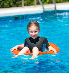 happy little girl in a wetsuit