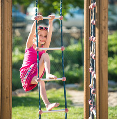 little girl on outdoor playground